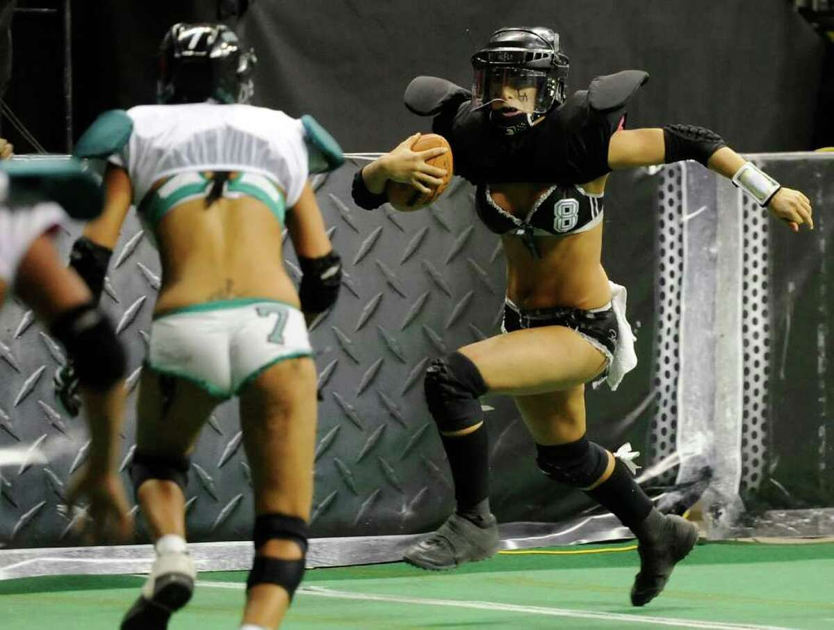 LAS VEGAS, NV - FEBRUARY 06: Quarterback Ashley Salerno #8 of the Los Angeles Temptation runs for yardage against the Philadelphia Passion during the Lingerie Football League's Lingerie Bowl VIII at the Thomas & Mack Center February 6, 2011 in Las Vegas, Nevada. Los Angeles won 26-25. (Photo by Ethan Miller/Getty Images)