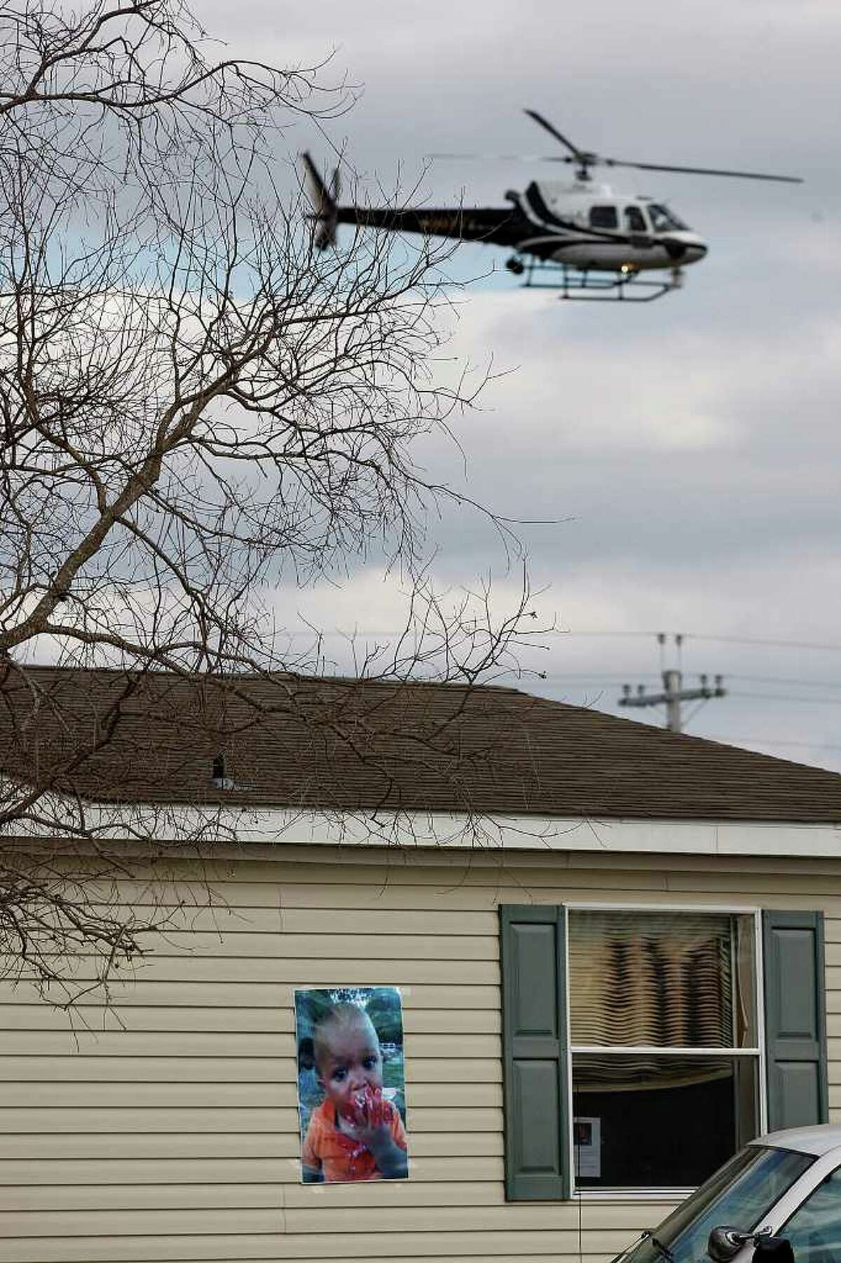A Department of Public Safety helicopter flies over the home of missing 18-month-old Joshua Davis, Jr. in New Braunfels on Feb. 8.