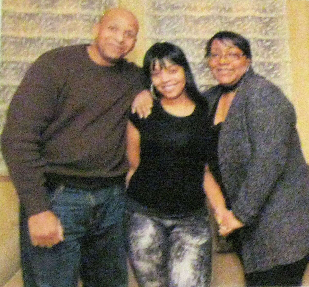 A photo taken off a banner hung in Joy White's apartment in the Hunts Point neighborhood of the Bronx shows Carlina White, birth parents, Carl Tyson and Joy White. Carlina was kidnapped from Harlem Hospital in 1987 and raised in Bridgeport as Nejdra Nance.