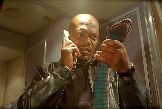 "Samuel L. Jackson finds himself knee-deep in slithering, slimy critters in the 2005 film ""Snakes On A Plane."" Photo: James Dittiger, New Line Productions / handout cd"
