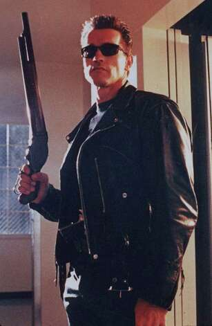 "FILE-- TERMINATOR 2: JUDGMENT DAY -- Arnold Schwarzenegger is shown in this undated file photo from a scene in the movie 'Terminator 2.' Schwarzenegger is in talks to reprise his cyborg role in a third installment of the ``Terminator'' franchise with James Cameron planning to write and produce the movie, Daily Variety reported Tuesday, Dec. 15 1998. No deals have been signed, but enthusiasm is high, the industry publication said. (AP Photo/file)   HOUCHRON CAPTION (05/31/2004):  Hollywood loves to depict the end of the world in movies such as ""The Terminator"" and ""The Day After Tomorrow"" -- and we can't get enough.  HOUSTON.  HOUCHRON CAPTION (05/31/2004):  Technology threatens the Earth in the ""Terminator"" series starring Arnold Schwarzenegger as a cyborg. Photo: ZADE ROSENTHAL, HO / TRISTAR PICTURES"
