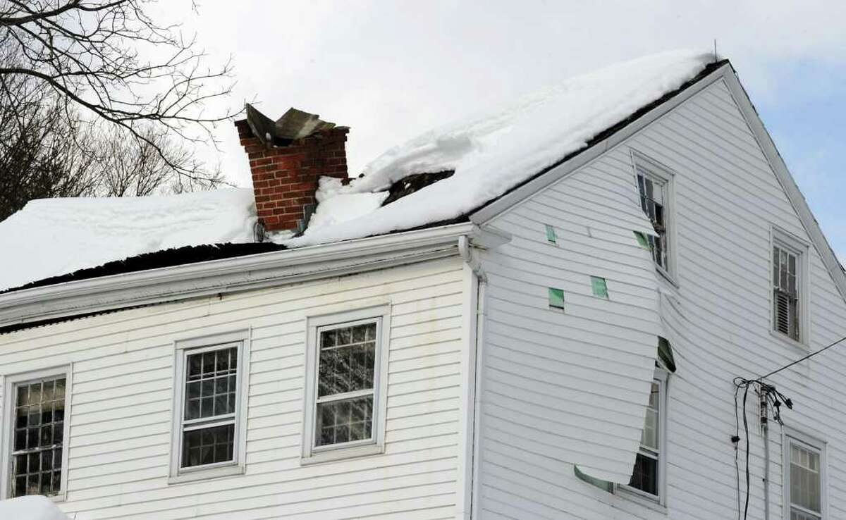 The roof caved in on an unoccupied house on Wasserman Way in Newtown Tuesday, February 8, 2011.
