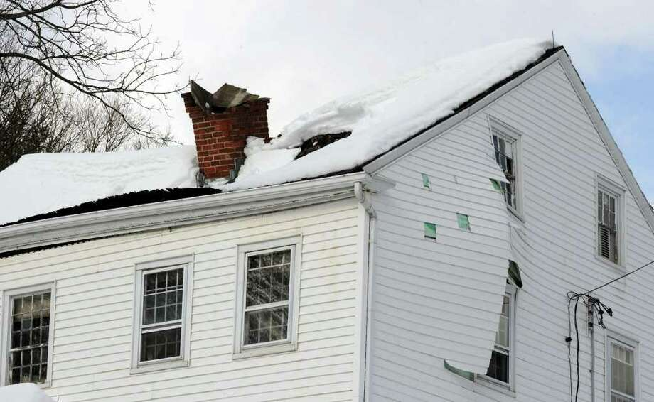Weighted With Snow And Ice Two Roofs In Newtown Collapse