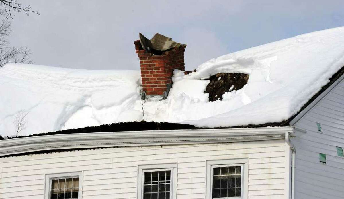 The roof caved in on an unoccupied house on Wasserman Way in Newtwon Tuesday, February 8, 2011.