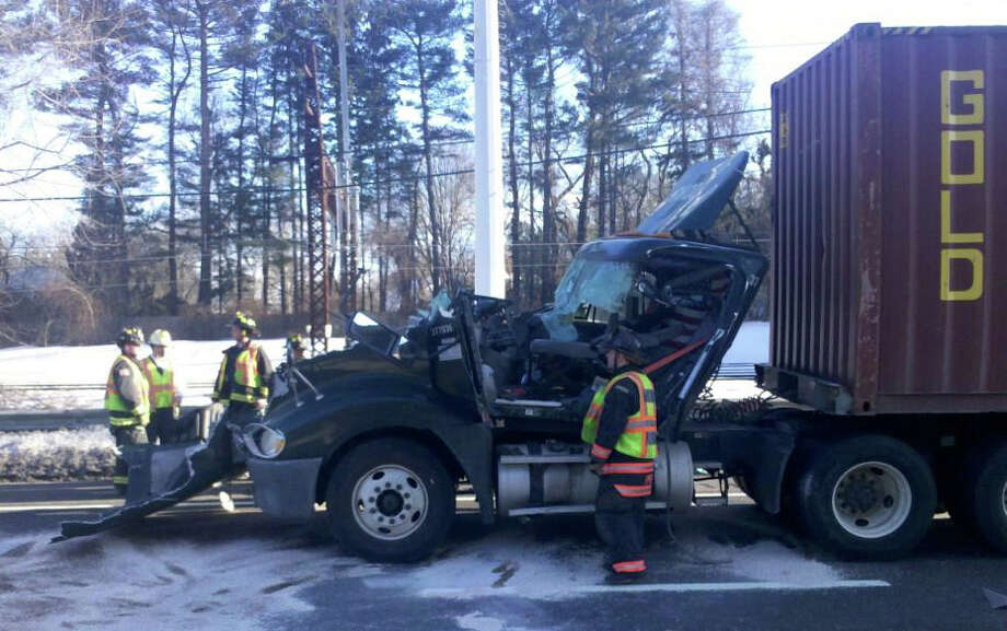 Pictured is the damage to the cab of a tractor trailer after it went up flames on I-95 northbound between exits 18 and 19. The tractor trailer allegedly struck the back of a car carrier, whose driver apparently knew nothing of the strike. Photo: Contributed Photo / Fairfield Citizen contributed