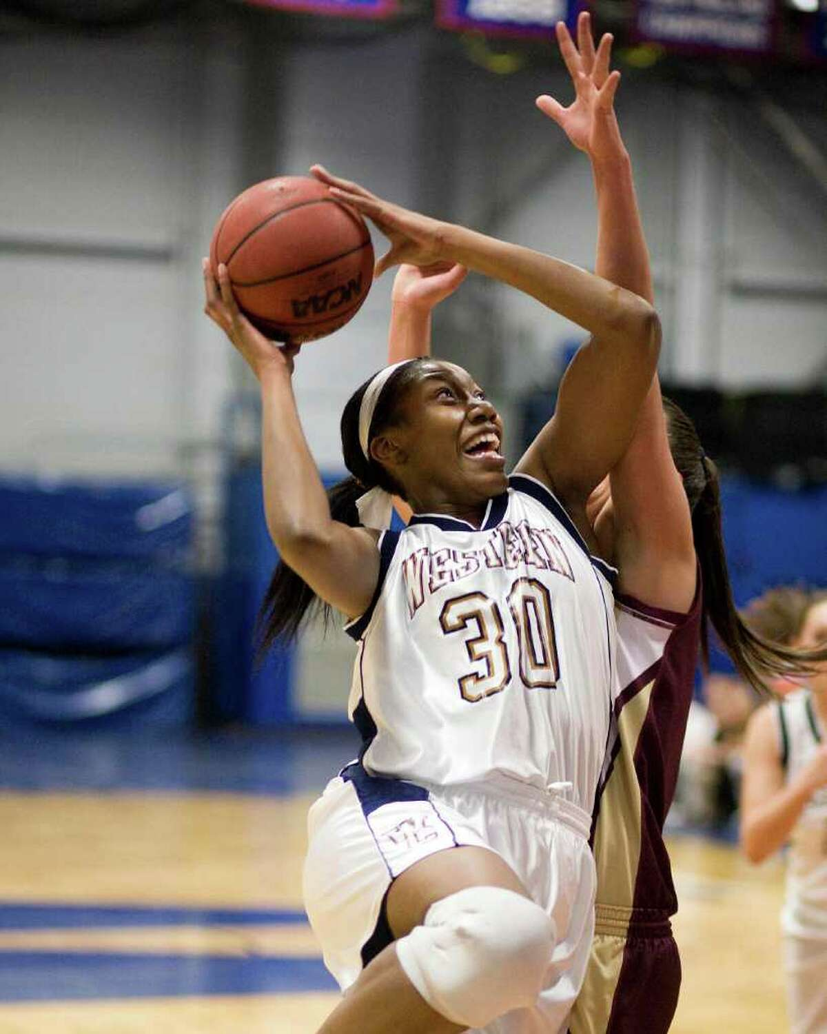 WCSU's Melissa Teel takes the ball to the basket during an LEC game against Rhode Island College Tuesday night at the Feldman Arena.