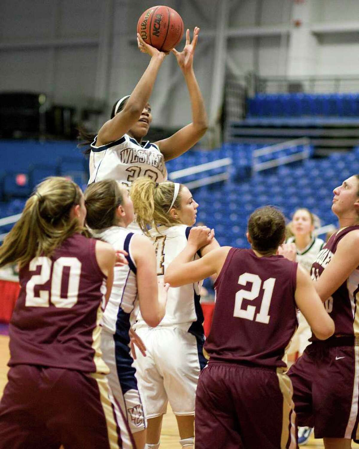 WCSU's Melissa Teel elevates for a jump shot against Rhode Island College Tuesday night at the Feldman Arena.