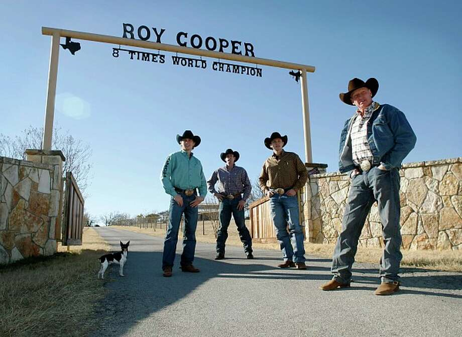 Clif Cooper (from left), Clint Cooper, Tuf Cooper, and their father, Roy Cooper, stand in front of the gate at Roy's Decatur home Thursday, January 27th, 2011. Clint, 29, will compete at the AT&T Center through Thursday, while Clif, 23, and Tuf, 21, are scheduled to run Feb. 13-16. Photo: MARK ROGERS/SPECIAL TO THE EXPRESS-NEWS