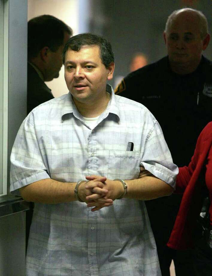 Michael Alcoser,  principal at Miguel Carillo Elementary School, is escorted by police officers after he was arrested on Tuesday, Jan. 29, 2008, for aggravated sexual assault. Photo: BOB OWEN, SAN ANTONIO EXPRESS-NEWS / SAN ANTONIO EXPRESS-NEWS