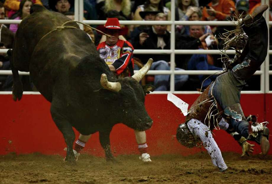 Bull rider Jarrod Ford of Greeley, Colo., gets tossed off his ride in rodeo competition Tuesday, Feb. 8, 2011 at the San Antonio Stock Show & Rodeo. Photo: Lisa Krantz, SAN ANTONIO EXPRESS-NEWS / lkrantz@express-news.net