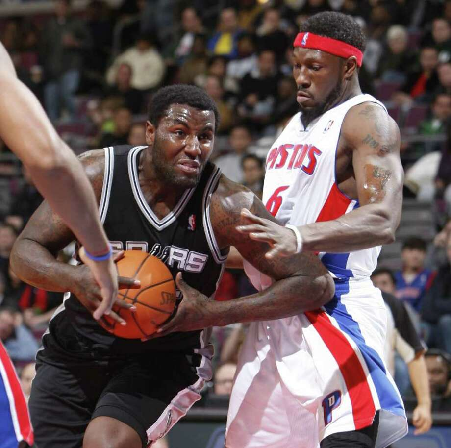 Detroit Pistons' Ben Wallace defends against the San Antonio Spurs' DeJuan Blair, Tuesday, February 8, 2011 at The Palace of Auburn Hills in Auburn Hills, Michigan. Photo: KIRTHMON  F. DOZIER, MCT / Detroit Free Press