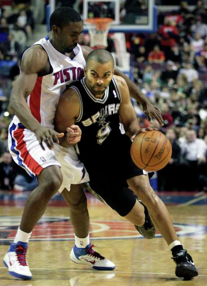 San Antonio Spurs' Tony Parker, right, of France, drives against Detroit Pistons' Ben Gordon, left, in the first half of an NBA basketball game Tuesday, Feb. 8, 2011, in Auburn Hills, Mich. Parker led the Spurs with 19 points in a 100-89 win over the Pistons. Photo: AP