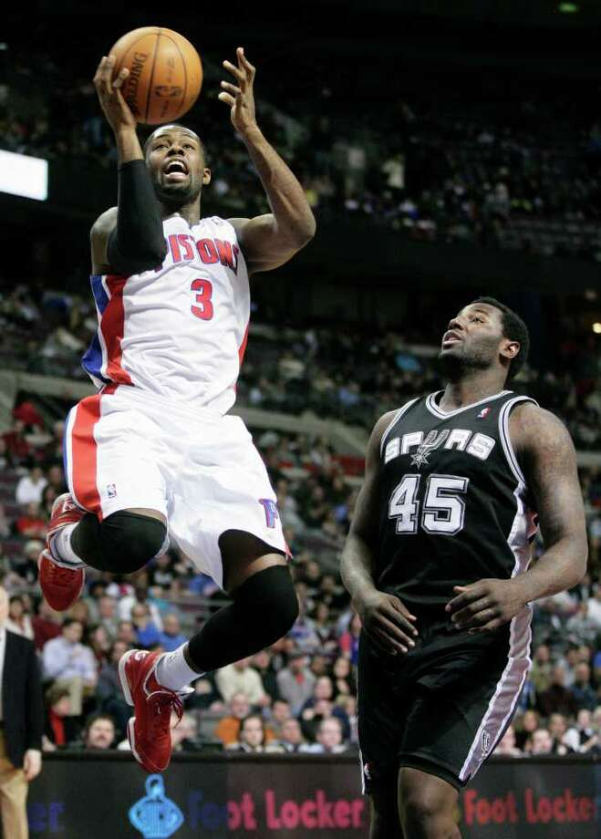 Detroit Pistons' Rodney Stuckey (3) goes to the basket past San Antonio Spurs' DeJuan Blair (45) in the second half of an NBA basketball game, Tuesday, Feb. 8, 2011, in Auburn Hills, Mich. The Spurs defeated the Pistons 100-89. Photo: AP