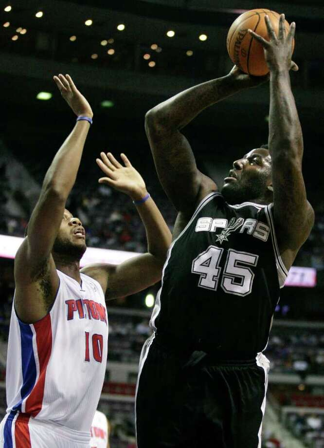 San Antonio Spurs' DeJuan Blair (45) takes a shot against Detroit Pistons' Greg Monroe (10) in the first half of an NBA basketball game, Tuesday, Feb. 8, 2011, in Auburn Hills, Mich. Photo: AP