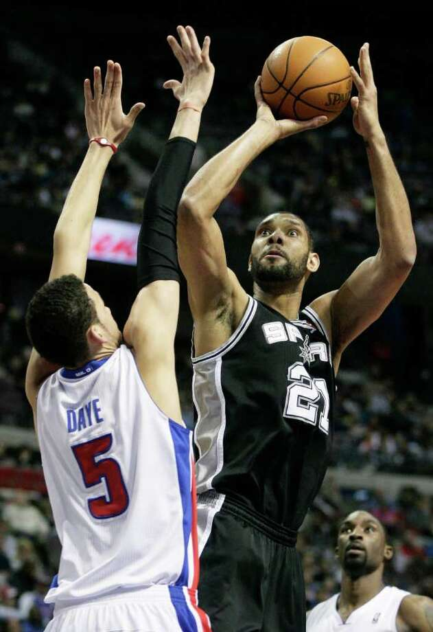 San Antonio Spurs' Tim Duncan (21) takes a shot against Detroit Pistons' Austin Daye (5) in the second quarter of an NBA basketball game, Tuesday, Feb. 8, 2011, in Auburn Hills, Mich. Photo: AP