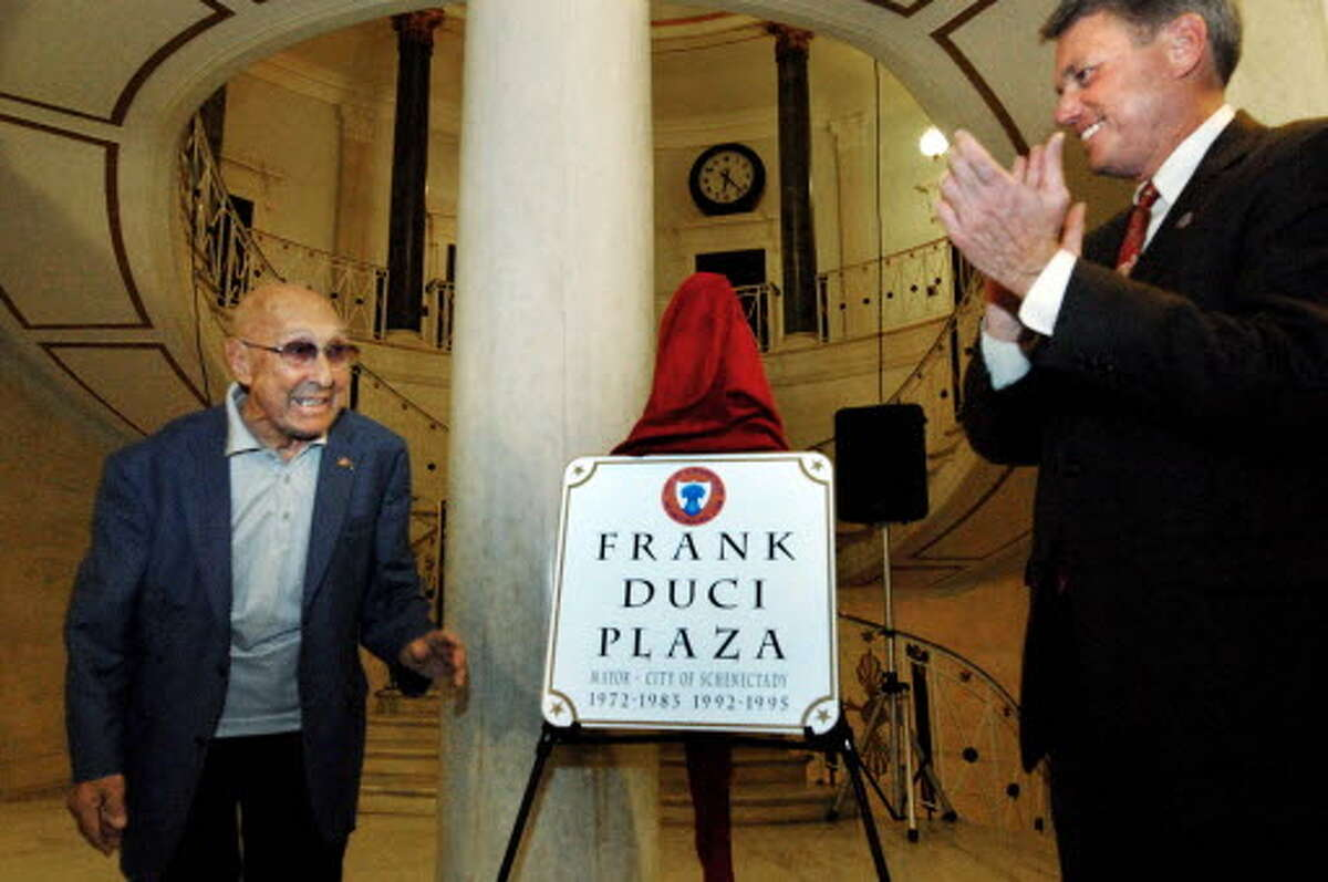 Former Schenectady Mayor Frank Duci , left, who served for a total of 16 years, is honored by the city of Schenectady and current Mayor Brian Stratton on Oct. 16, 2009. A portion of Avenue A , where he lives, was renamed Frank Duci Plaza during the ceremony in the rotunda of City Hall. (Michael P. Farrell / Times Union archive).