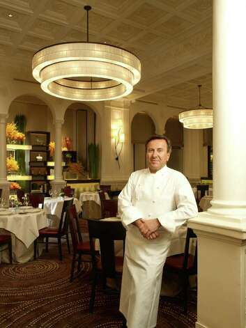 Chef Daniel Boulud takes a minute away from the kitchen to pose in his award-winning restaurant, Daniel, in Manhattan. Photo: Contributed Photo / Greenwich Citizen