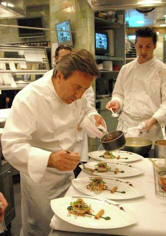"Here, Daniel Boulud carefully plates one of his culinary creations at Daniel NYC in Manhattan, cited as ""one of the best restaurants in the world"" and awarded membership in the Relais & Chateaux organization. Photo: Contributed Photo / Greenwich Citizen"