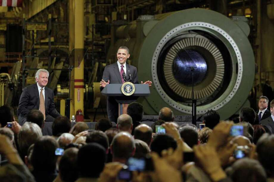 President Barack Obama, accompanied by GE CEO Jeffrey Immelt, left, delivers remarks at the General Electric plant in Schenectady, N.Y., Friday, Jan. 21, 2011. Obama's fiscal year 2012 defense budget could halt production of a GE engine and force other government contractors to defend programs by proving they can save money.  (AP Photo/Richard Drew) Photo: Richard Drew, ST / AP2011