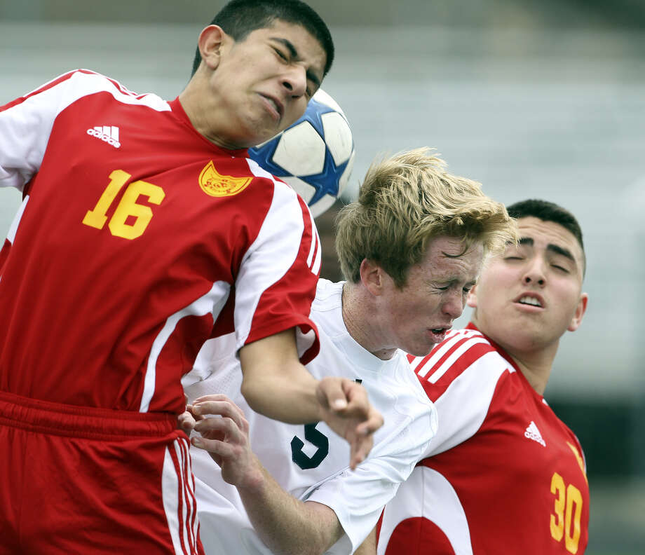 The Buttons' Patrick Fleming (5) battles for control with Luis Fuentes (16) and Daniel De La Garza as Central Catholic plays Harlingen MMA in boys soccer at Bob Benson Field on February 8, 2011. Photo: Tom Reel/treel@express-news.net
