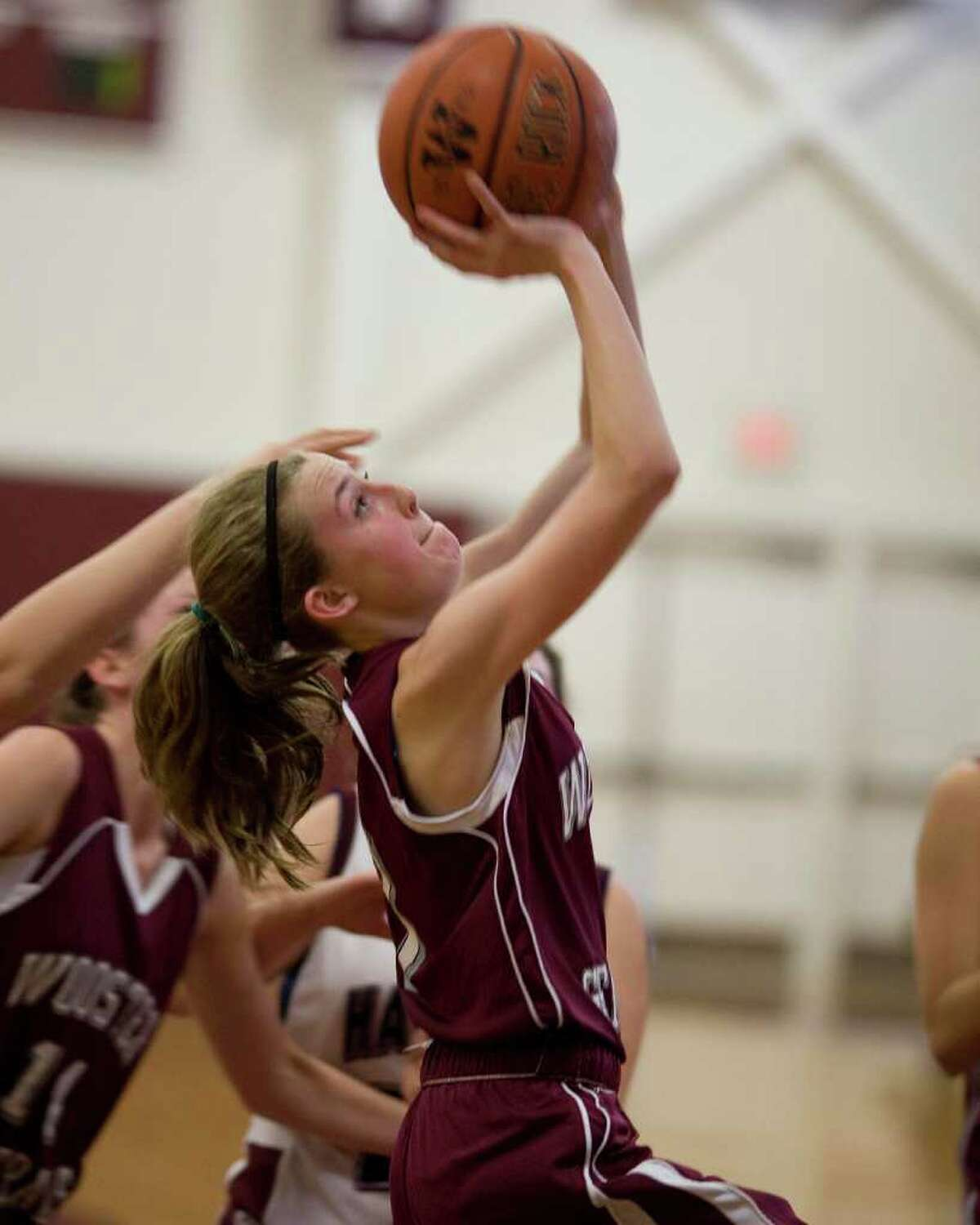 Wooster's Kate MacNutt drives the baseline against Harvey Wednesday at Wooster School.
