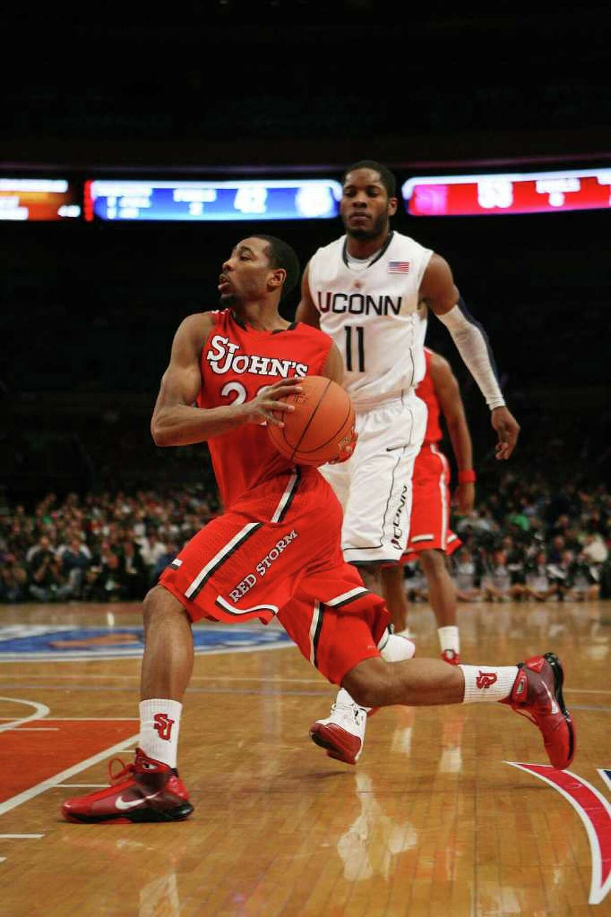 NEW YORK - MARCH 09: Paris Horne #23 of the St. John's Red Storm drives past Jerome Tyson #11 the Connecticut Huskies at Madison Square Garden on March 9, 2010 in New York, New York. The Red Storm defeated the Huskies 73-51. (Photo by Chris Trotman/Getty Images) *** Local Caption *** Paris Horne;Jerome Tyson