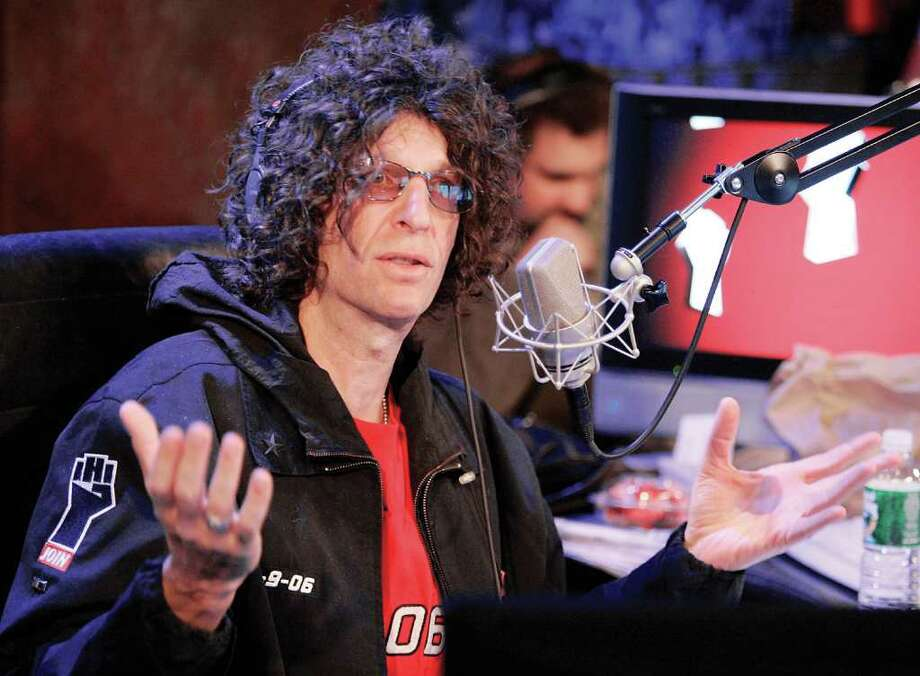 Radio personality Howard Stern responds to a question at an on-air news conference during his debut show on Sirius Satellite Radio, in New York, Jan. 9, 2006. (AP Photo/Richard Drew) Photo: Contributed Photo / Greenwich Time Contributed