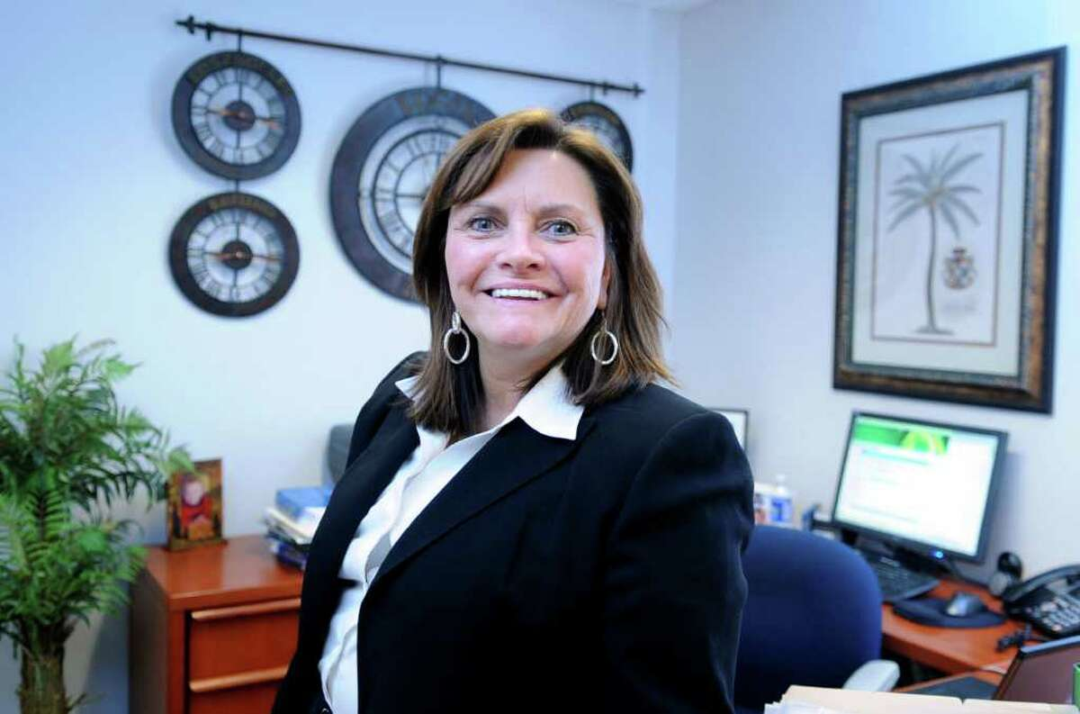 Virginia DeDad, owner of Royal Service Travel, stands in her Shelton office Wednesday, Feb. 9, 2011.