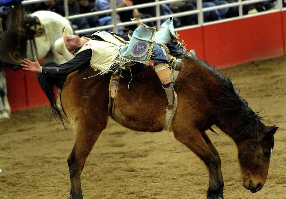 J.R. Vezain, 18, of Cowley, Wyo., hangs on during bareback riding Wednesday, Feb. 9, 2011, at the San Antonio Stock Show & Rodeo. Photo: BILLY CALZADA, SAN ANTONIO EXPRESS-NEWS / gcalzada@express-news.net