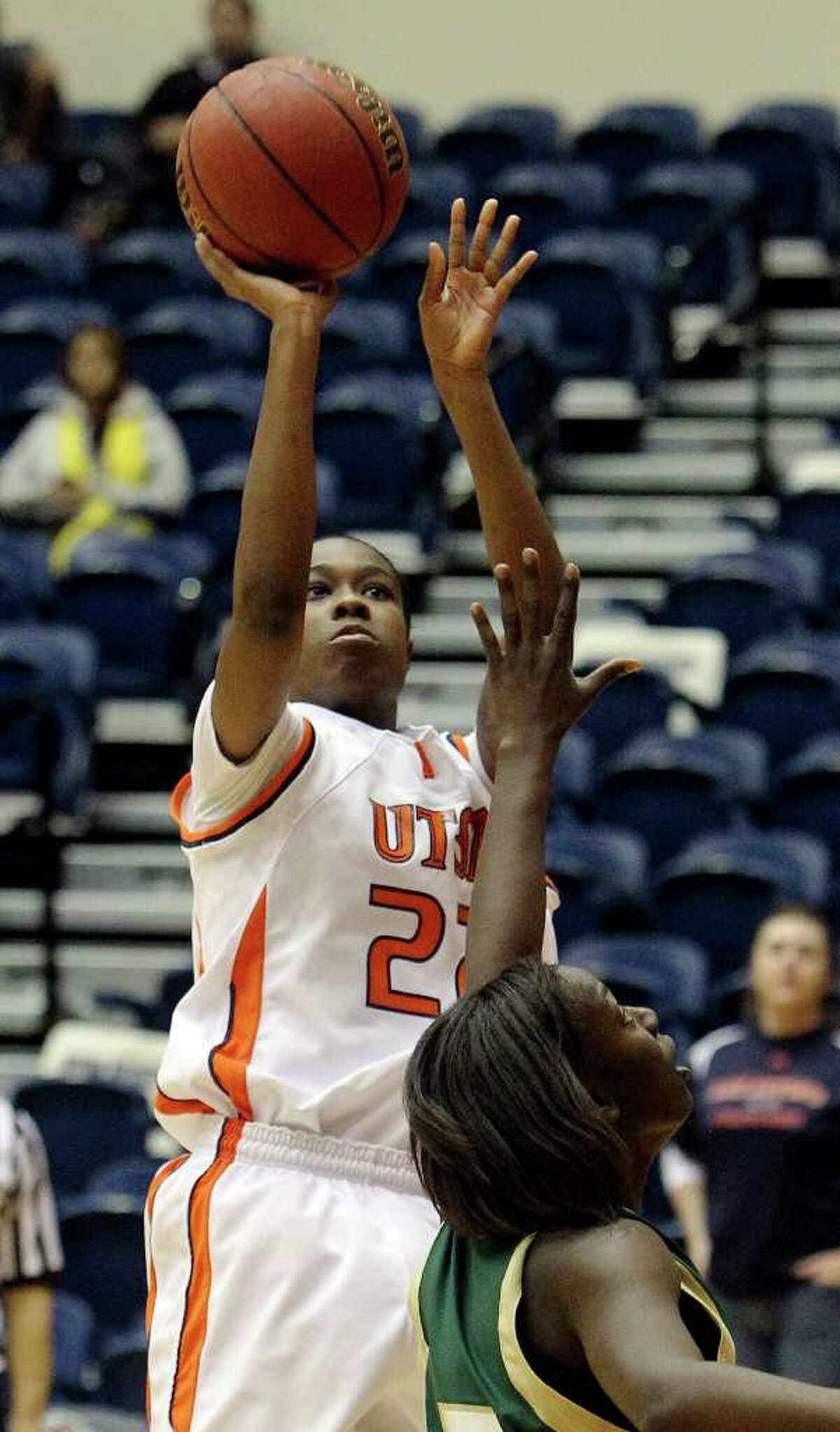 UTSA Lady Roadrunners' Ashley Gardner (22) shoots over Southeastern Louisiana's Rashima Jenkins (15) on Wednesday, Feb. 9, 2011. Kin Man Hui/kmhui@express-news.net