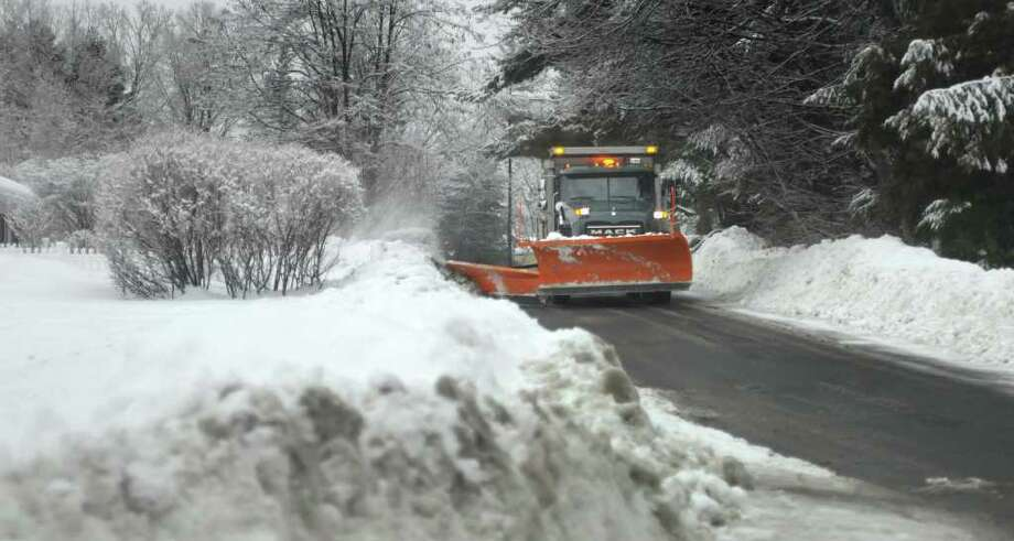 A town snowplow clears the edges of Eastview Rd. in Latham, NY on Tuesday, Feb. 8, 2011.  (Paul Buckowski / Times Union) Photo: Paul Buckowski