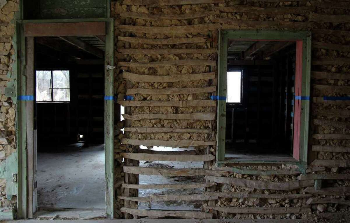 The walls of the home on the Blas Herrera Ranch were built using a construction method called jacal. Cedar posts stand vertically, and strips of cypress were nailed horizontally connecting the posts. Rubble stone was inserted between the slats, and then the wall was slathered with mud and plastered. The final step was usually a white wash.
