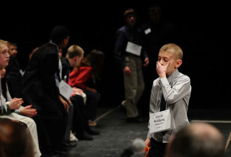 Gavin Wolfgang, of Albany, walks off the stage Wednesday after misspelling a word in the 2011 Capital Region Spelling Bee at Proctors. ( Philip Kamrass / Times Union ) Photo: PHILIP KAMRASS