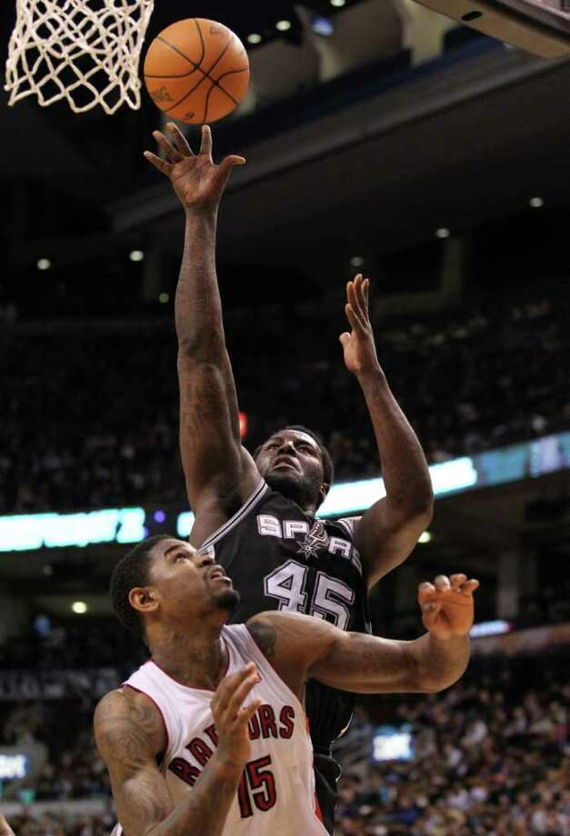 San Antonio Spurs center DeJuan Blair shoots over Toronto Raptors forward during the second half of an NBA basketball game in Toronto on Wednesday, Feb. 9, 2011. Photo: AP
