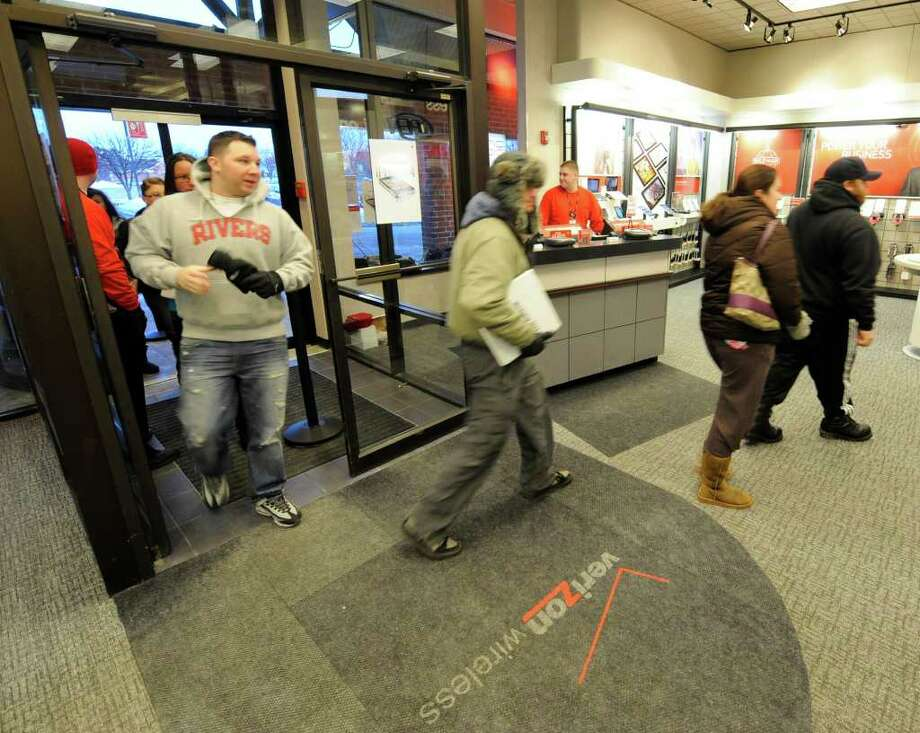 iPhone shoppers get up early Thursday to buy the iPhone, which went on sale at 7 a.m. at the Verizon store in Colonie. (Skip Dickstein / Times Union) Photo: Skip Dickstein