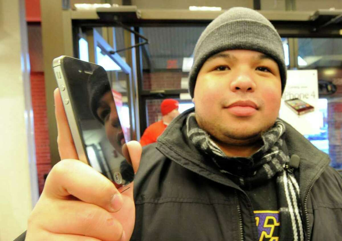 Rolando Andres of Guilderland and a student at SUNY Albany, began waiting at 5 a.m. Thursday at the Verizon store in Colonie to buy an iPhone for his girlfriend for Valentine's Day. (Skip Dickstein / Times Union)