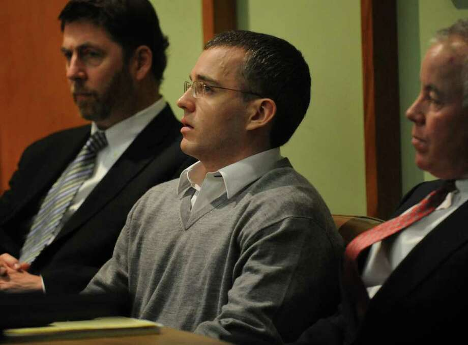 Christopher DiMeo listens after a jury returned a verdict of guilty on all counts in Superior Court in Bridgeport, Conn. Feb. 9th, 2011. DiMeo was found guilty of two counts of murder and one count each of first-degree robbery and capital felony in the deaths of Tim and Kim Donnelly during the robbery of their Fairfield jewelry store in February of 2005. DiMeo is seen here with defense attorneys Jeffrey Hutcoe and Michael Courtney. Photo: Brian A. Pounds / Connecticut Post