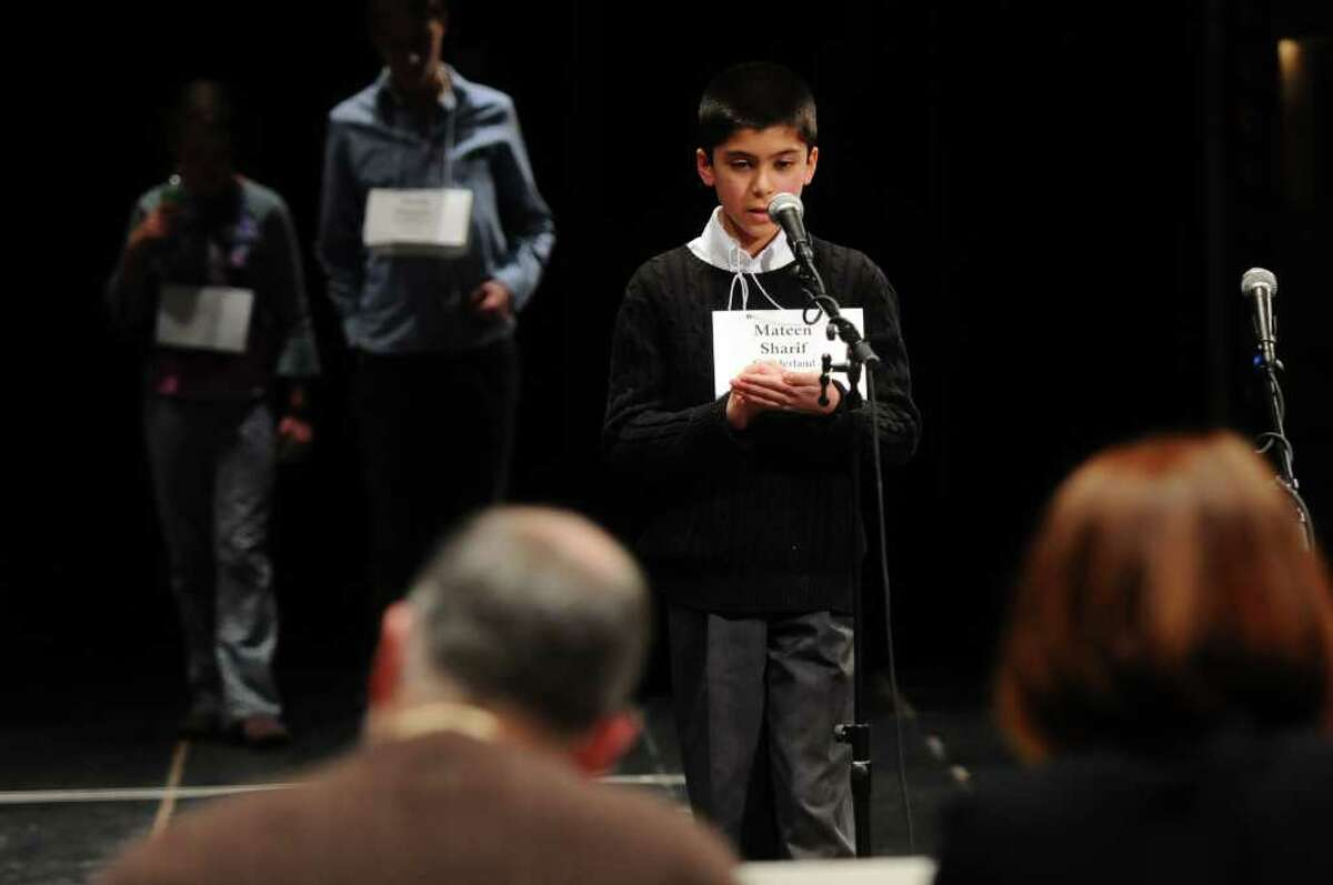 Mateen Sharif, a sixth-grader from Guilderland, spells a word for the judges Wednesday on his way to winning the 2011 Capital Region Spelling Bee at Proctors. ( Philip Kamrass / Times Union )