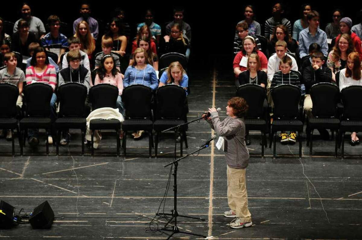 Adam Becker, a seventh-grader from Burnt Hills-Ballston Lake, is up Wednesday during the 2011 Capital Region Spelling Bee at Proctors in Schenectady on Wednesday. ( Philip Kamrass / Times Union )