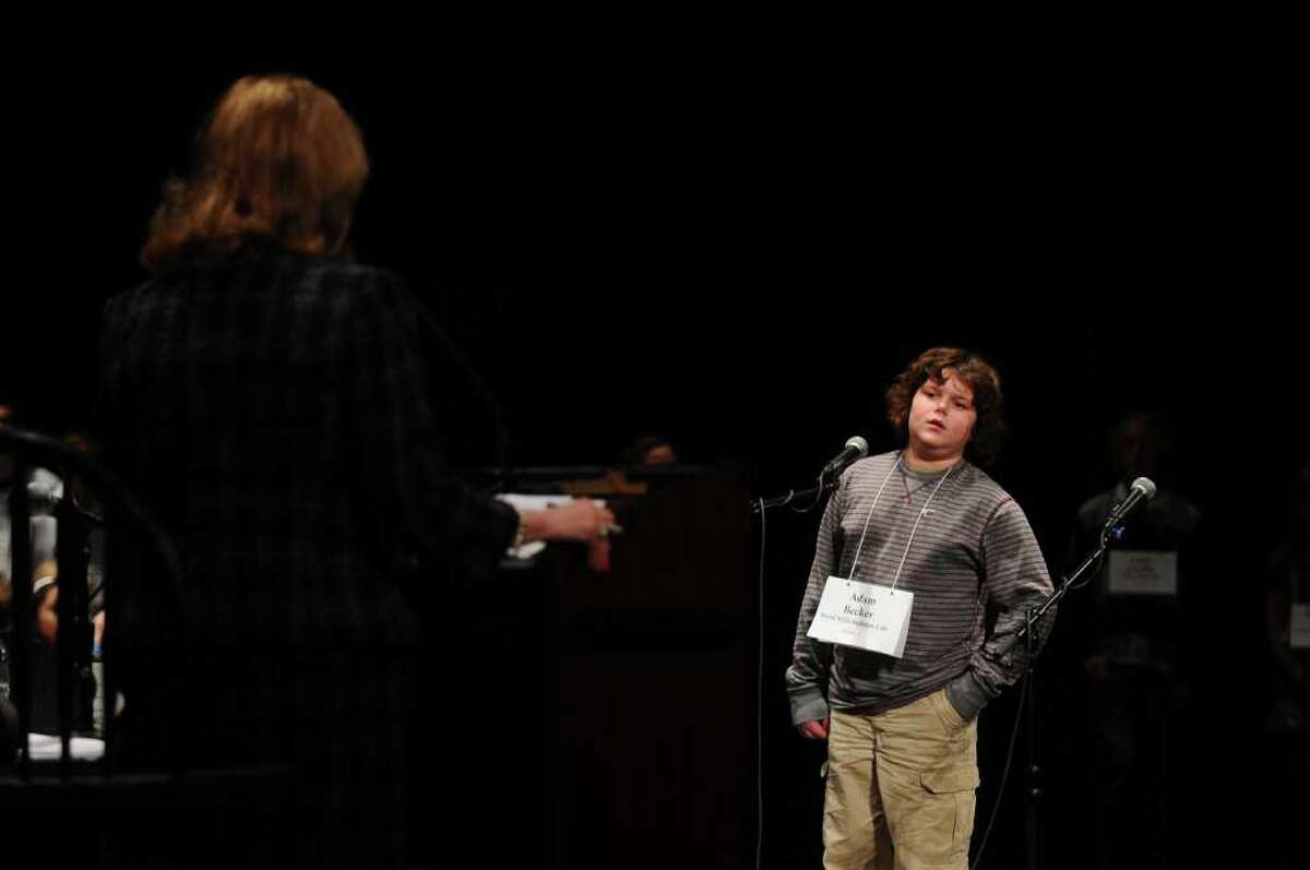 Adam Becker, a seventh-grader from Burnt Hills-Ballston Lake, spells a word for the judges during the 2011 Capital Region Spelling Bee at Proctors in Schenectady on Wednesday. ( Philip Kamrass / Times Union )