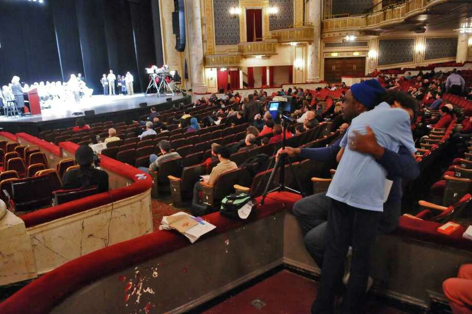 "Benzie Johnson, a seventh-grader from Albany, is comforted by his father, Benzie, after his son misspelled the word ""satori"" during  the 2011 Capital Region Spelling Bee at Proctors in Schenectady on Wednesday.  ( Philip Kamrass / Times Union ) Photo: PHILIP KAMRASS"