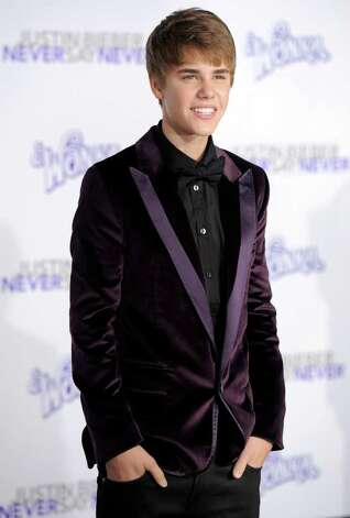 "Justin Bieber, subject of the documentary film ""Justin Bieber: Never Say Never,"" arrives at the premiere of the film in Los Angeles, Tuesday, Feb. 8, 2011. Photo: AP"