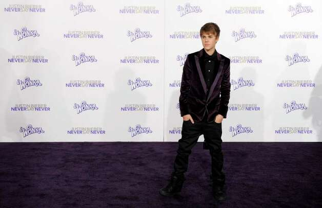 "Justin Bieber poses at the premiere of the documentary film ""Justin Bieber: Never Say Never,"" in Los Angeles, Tuesday, Feb. 8, 2011. Photo: AP"