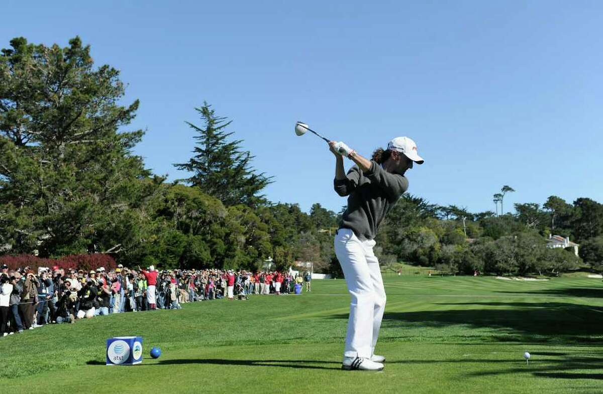 PEBBLE BEACH, CA - FEBRUARY 09: Musician Kenny G plays a shot during the 3M Celebrity Challenge at the AT&T Pebble Beach National Pro-Am at Pebble Beach Golf Links on February 9, 2011 in Pebble Beach, California. (Photo by Stuart Franklin/Getty Images)