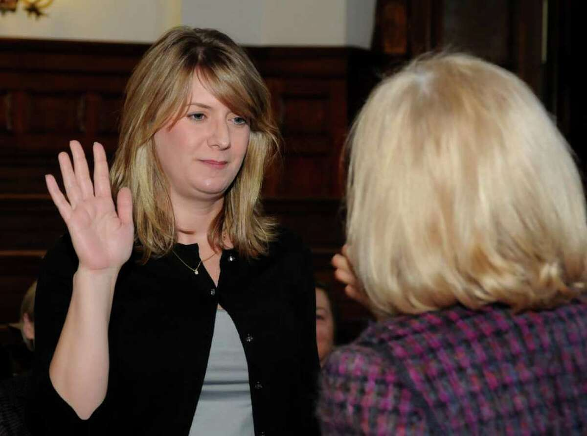 Deirdra Wallin, left, of Brookfield, gets sworn in by the Honorable Judge Mary E. Sommer as a child advocate for the Child Advocate of Connecticut program at Family Court in Danbury on Wednesday, Feb. 9, 2011.
