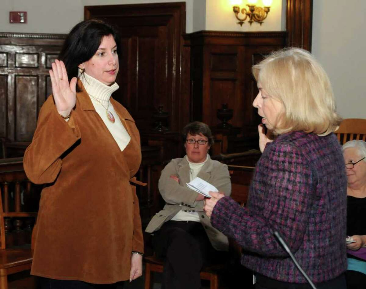 Lauren Ashton, left, of Redding, gets sworn in by Judge Mary E. Sommer as a child advocate for the Child Advocate of Connecticut program at Family Court in Danbury on Wednesday, Feb. 9, 2011.