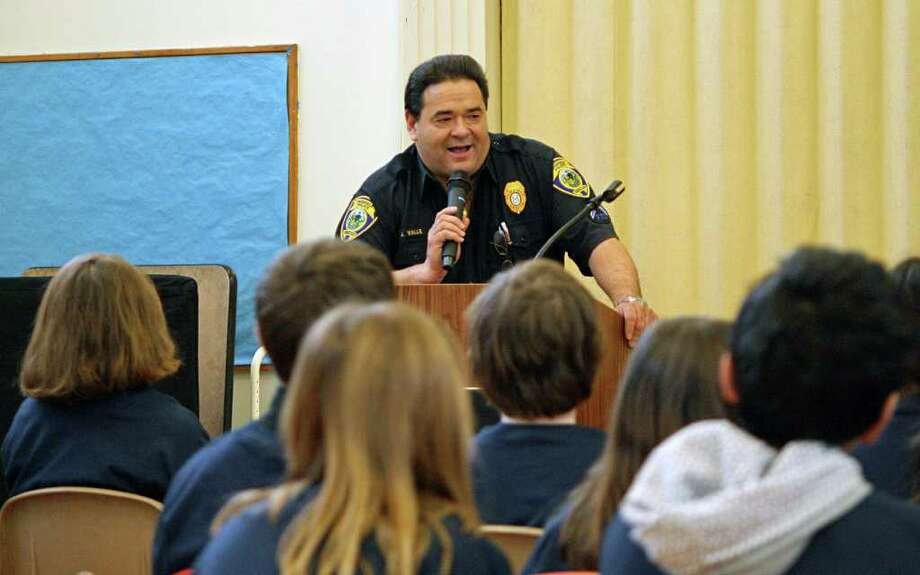 Officer Jay Valle addresses the fifth grade students at Holland Hill School during their D.A.R.E. graduation earlier this month. Photo: Contributed Photo / Fairfield Citizen