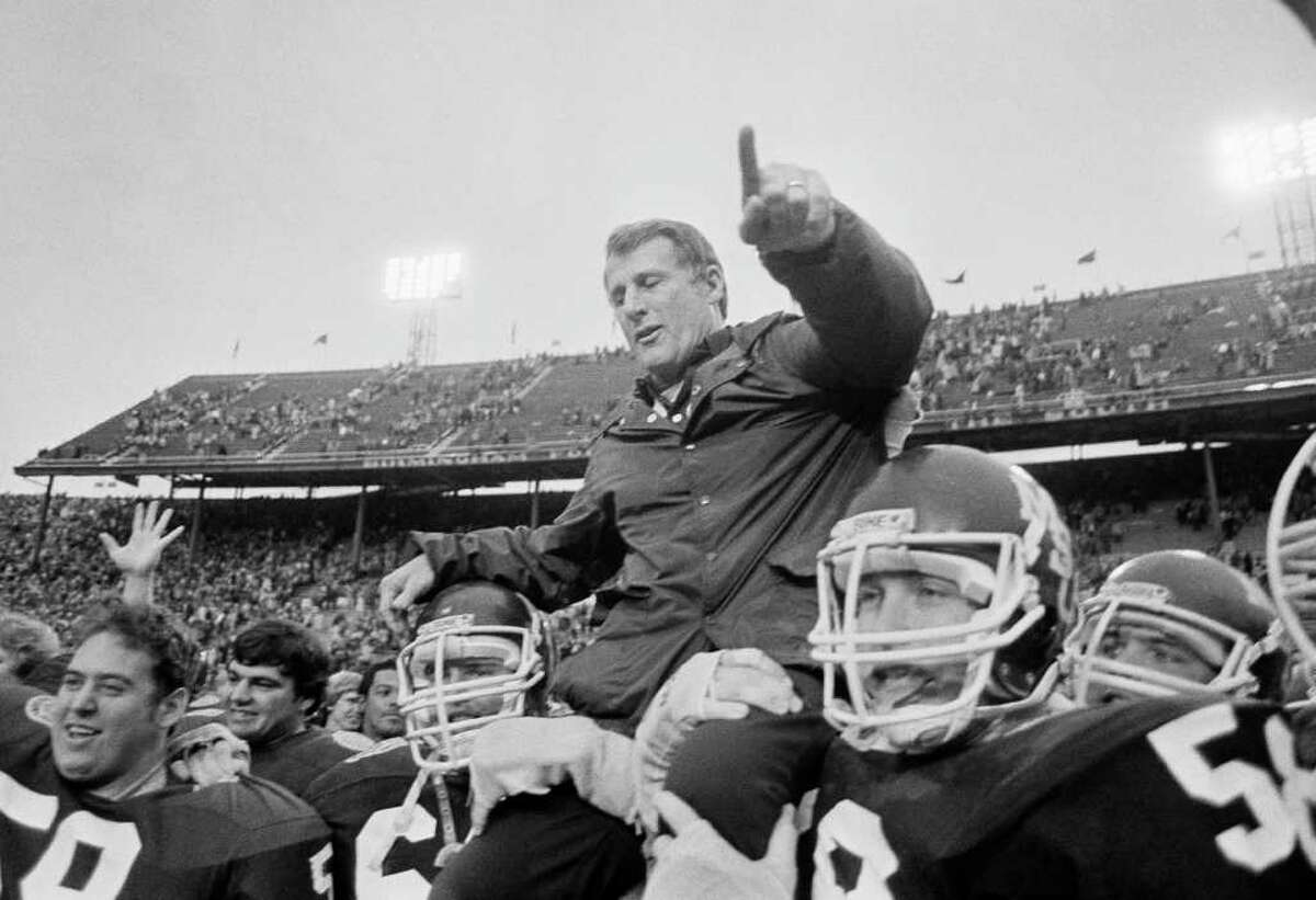 FILE - In this Dec. 31, 1981, file photo, Mississippi State's coach Emory Bellard is carried off the field on the shoulders of his players after their 10-0 victory over Kansas in the Hall of Fame Bowl NCAA college football game in Birmingham, Ala. Bellard, a former Texas A&M and Mississippi State coach credited with developing the wishbone offense when he was an assistant at Texas, died early Thursday, Feb. 10, 2011, at a care facility in Georgetown in Central Texas, Cathy Capps, director of the Texas A&M Lettermen's Association, said. He was 83.