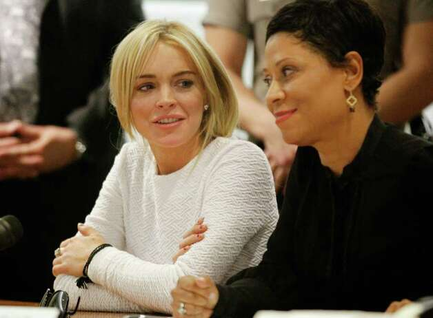 LOS ANGELES, CA - FEBRUARY 09:  Actress Lindsay Lohan (L) sits with her attorney Shawn Chapman Holley during her arraignment for a felony count of grand theft on February 9, 2011 in Los Angeles, California. Lohan was charged with a felony count of grand theft for allegedly stealing a $2,500 necklace from a jewelry store in Venice. (Photo by Mario Anzuoni-Pool\Getty Images) Photo: Pool