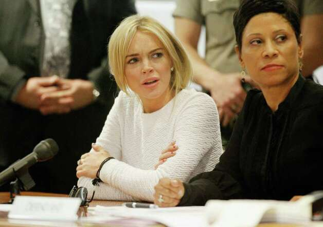 LOS ANGELES, CA - FEBRUARY 09:  Actress Lindsay Lohan (L) and her attorney Shawn Chapman Holley during her arraignment for a felony count of grand theft on February 9, 2011 in Los Angeles, California. Lohan was charged with a felony count of grand theft for allegedly stealing a $2,500 necklace from a jewelry store in Venice. (Photo by Mario Anzuoni-Pool\Getty Images) Photo: Pool